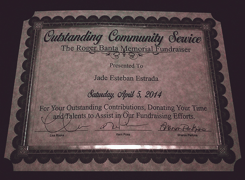 Outstanding Community Service Award given to comedian Jade Esteban Estrada for his performance at the Roger Dean Banta Memorial Fundraiser in April 2014.